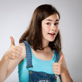 Young girl showing OK sign Stock Images