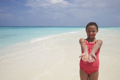 Young girl showing sea shells she�s collected on the beach Stock Photos