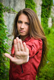 Young girl showing stop sign Royalty Free Stock Photography