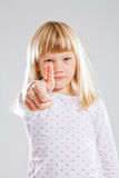 Young girl showing thumbs up sign Stock Photography
