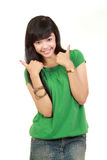 Young girl showing two thumbs up Stock Image