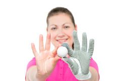 Young girl shows the ball for the game of golf on a white Royalty Free Stock Photography