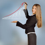 Young girl shows bar chart with red arrow Royalty Free Stock Photos