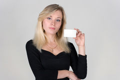 Young girl shows a blank plastic card Royalty Free Stock Photography
