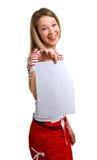 Young girl shows empty sheet Stock Photos