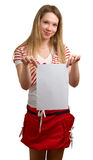 Young girl shows empty sheet of paper Stock Photography