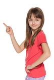 Young girl shows her finger to the side Stock Photo