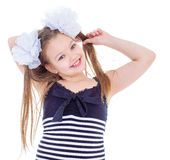 A young girl shows her finger to the side Stock Image