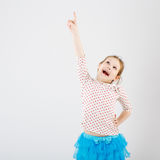 A young girl shows her finger to the side Stock Photos