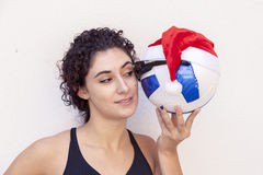 Young girl shows a soccer ball with glasses Royalty Free Stock Photo