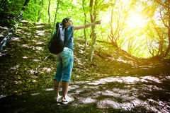 Young girl shows the way in forest Stock Images