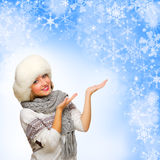 Young girl shows welcome gesture on winter background Stock Photos