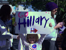 Young girl with sign supporting Hillary Clinton for president. Young girl holding sign at Hillary Clinton's rally in Des Moines, Iowa, prior to the Democrats' stock photos