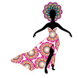 Young girl silhouette in chic long traditional dress Royalty Free Stock Images