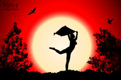 Young girl silhouette with shawl dancing on background of red sunset with trees, birds Royalty Free Stock Image