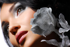 Young girl with silver rose Stock Photos