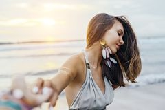 Young girl with silver tattoo and boho jewelry on sunset. Young teenage girl with silver tattoo and boho jewelry over shore on sunset royalty free stock photos