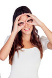 Young girl simulating glasses with his hands Royalty Free Stock Photos