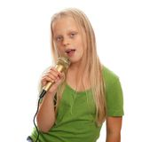 Young girl singer Royalty Free Stock Photography