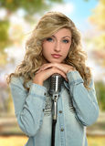 Young Girl Singer with microphone Royalty Free Stock Images
