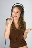 Young girl singing Stock Images