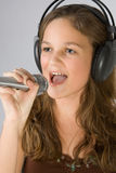 Young girl singing Royalty Free Stock Images