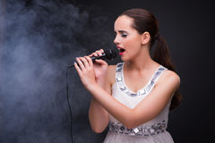 The young girl singing in karaoke club Royalty Free Stock Photo