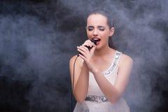 The young girl singing in karaoke club Stock Photo