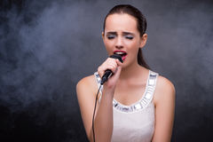 The young girl singing in karaoke club Royalty Free Stock Photos