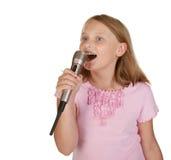 Young girl singing karaoke on white Royalty Free Stock Image