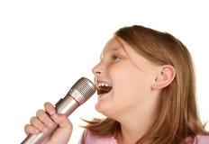 Young girl singing karaoke on white Stock Photo