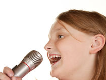 Young girl singing karaoke on white Royalty Free Stock Photo