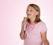 Young girl singing karaoke on white Royalty Free Stock Images
