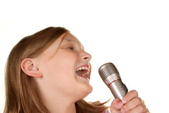 Young girl singing karaoke on white Stock Image