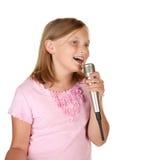 Young girl singing karaoke on white Stock Photos