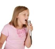 Young girl singing karaoke on white Stock Image