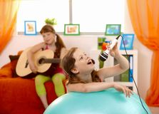 Young girl singing into microphone Royalty Free Stock Photo