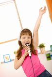 Young Girl Singing With Hand Up High Royalty Free Stock Photo