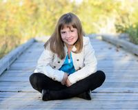 Young girl sitting Royalty Free Stock Photo
