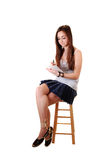 Young girl sitting. Stock Images