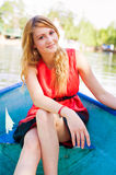 Girl in the boat. Portrait of a young girl sitting in the boat Royalty Free Stock Images