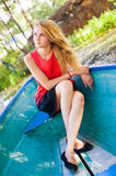 Girl and boat. Portrait of a young girl sitting in the boat Royalty Free Stock Image