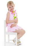Young girl sitting with a bunch of flowers. Royalty Free Stock Photo