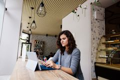 Girl with a laptop in a cafe. stock photos
