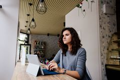 Girl with a laptop in a cafe. stock images