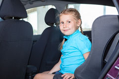 Young girl sitting in car safety seat Royalty Free Stock Photography