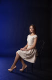 Young girl sitting on a chair Royalty Free Stock Photography