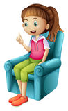 A young girl sitting on a chair Stock Photo