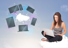 Young girl sitting on cloud enjoying cloud network service Stock Image