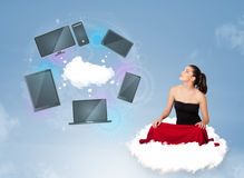 Young girl sitting on cloud enjoying cloud network service Stock Photo